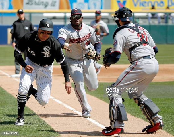 Miguel Sano of the Minnesota Twins commits a throwing error as Avisail Garcia of the Chicago White Sox is able to safely steal home on a pick off...