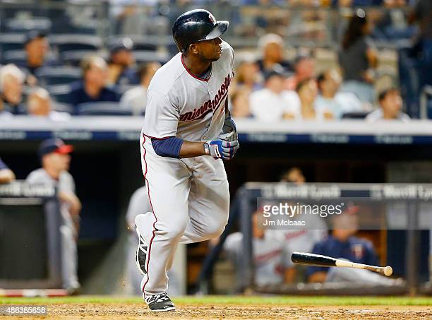 Miguel Sano of the Minnesota Twins follows through on a third inning two run home run against the New York Yankees at Yankee Stadium on August 17...