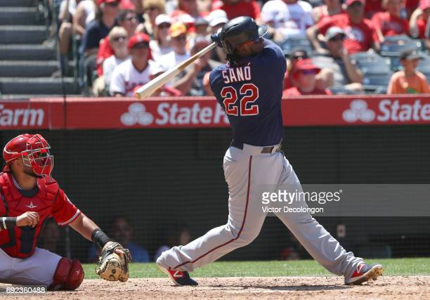 Miguel Sano of the Minnesota Twins hits a tworun homerun in the sixth inning during the MLB game against the Los Angeles Angels of Anaheim at Angel...