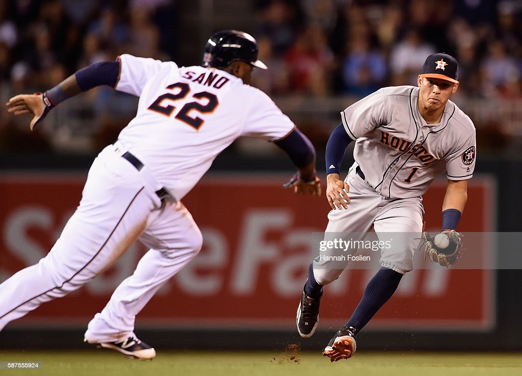 Miguel Sano #22 of the Minnesota Twins is caught off second base by Carlos Correa #1 of the Houston Astros to start a double play during the sixth inning of the game on August 8, 2016 at Target Field in Minneapolis, Minnesota. The Twins defeated the Astros 3-1.