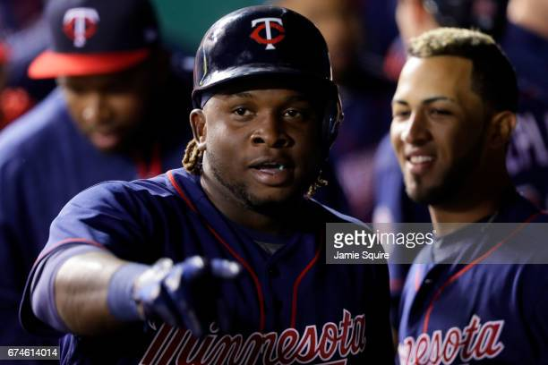 Miguel Sano of the Minnesota Twins is congratulated by teammates in the dugout after hitting a tworun home run during the 4th inning of the game...
