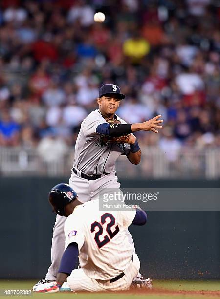 Miguel Sano of the Minnesota Twins is out at second base as Ketel Marte of the Seattle Mariners turns a double play sixth inning of the game on...