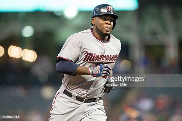 Miguel Sano of the Minnesota Twins rounds the bases on a hit by Trevor Plouffe during the first inning against the Cleveland Indians at Progressive...