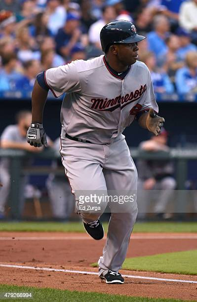 Miguel Sano of the Minnesota Twins runs to first as he flies out in the second inning against the Kansas City Royals at Kauffman Stadium on July 2...