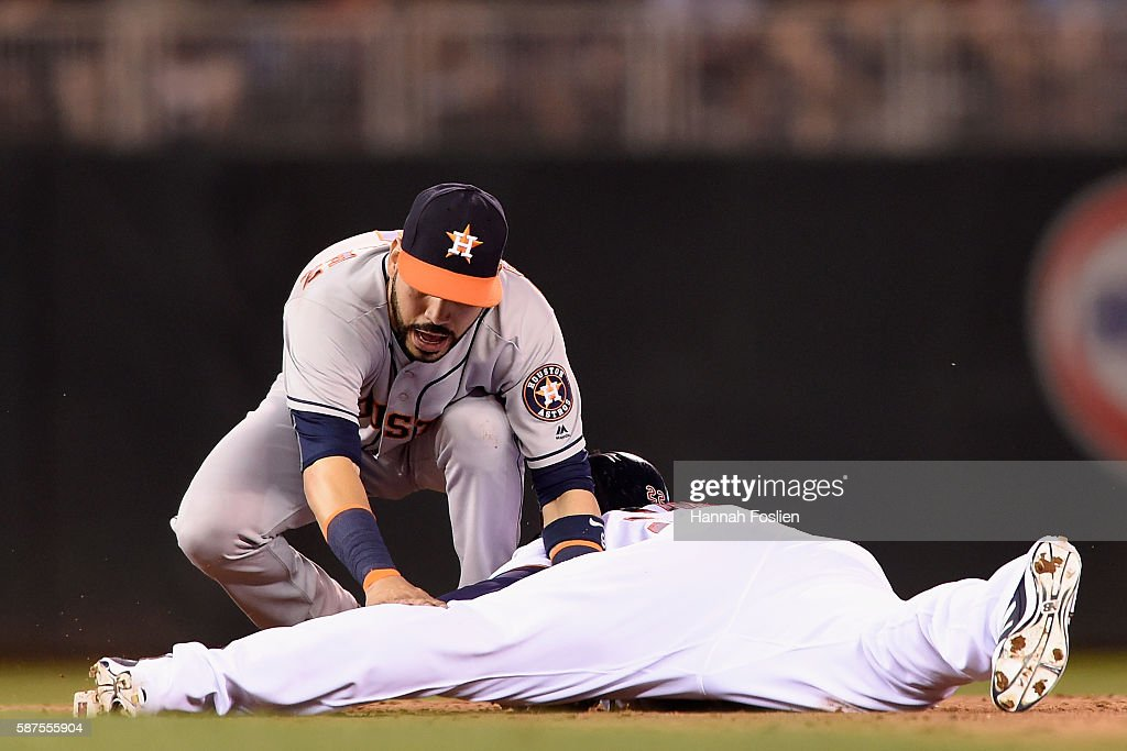 Miguel Sano #22 of the Minnesota Twins slides into second base safely with a double against Marwin Gonzalez #9 of the Houston Astros during the sixth inning of the game on August 8, 2016 at Target Field in Minneapolis, Minnesota. The Twins defeated the Astros 3-1.
