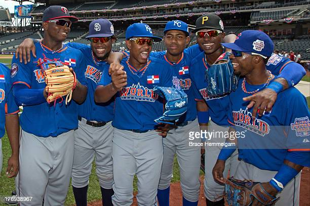 Miguel Sano Yeison Asencio Yordano Ventura Miguel Almonte Gregory Polanco and Arismendy Alcantara laugh before the game on July 14 2013 at Citi Field...