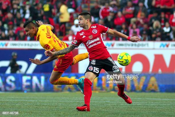 Miguel Sansores of Morelia and Damian Perez of Tijuana fight for the ball during the quarter finals second leg match between Tijuana and Morelia as...