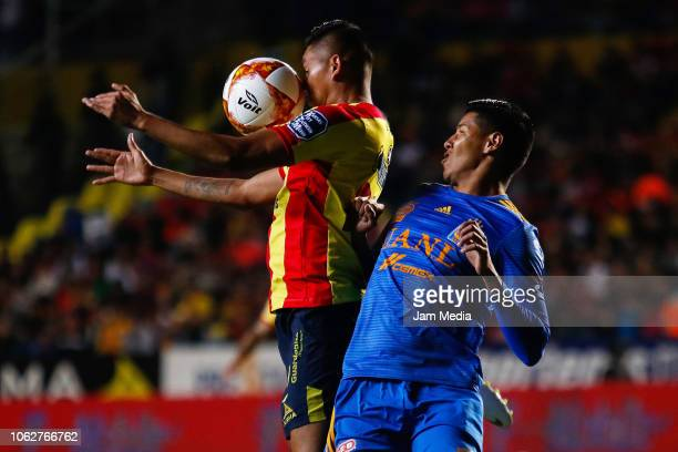 Miguel Sansores of Morelia fights for the ball with Hugo Ayala of Tigres during the 15th round match between Morelia and Tigres UANL as part of the...