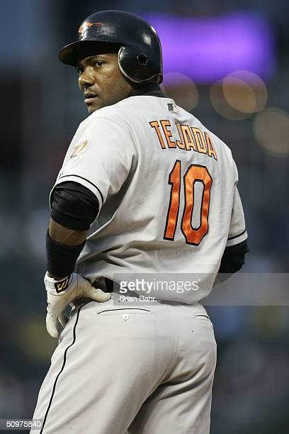 Miguel Tejada of the Baltimore Orioles stands on first base after hitting a single against the Colorado Rockies in the first inning on June 18 2004...