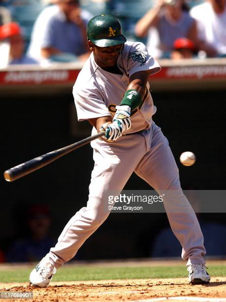 Miguel Tejeda of the A's makes contact for a double in the second inning and later scored on a Scott Hatteberg double in the same inning