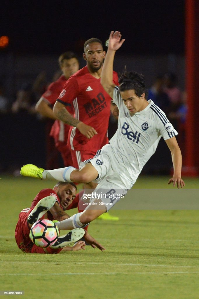 Miguel Timm #6 of Phoenix Rising FC makes a sliding tackle against Thomas Gardner #64 of Vancouver Whitecaps II in the second half of the match at Phoenix Rising Soccer Complex on June 10, 2017 in Phoenix, Arizona. The Phoenix Rising FC won 2-1.