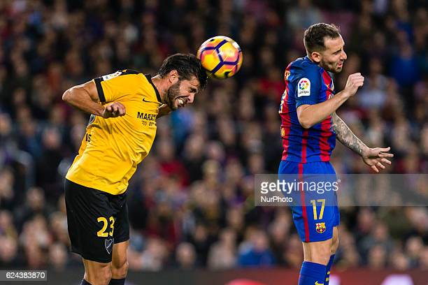 Miguel Torres and Paco Alcacer during the match between FC Barcelona vs Malaga CF for the round 12 of the Liga Santander played at Camp Nou Stadium...