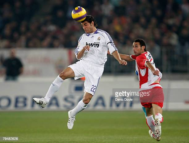 Miguel Torres of Real Madird intercepts the ball from Alvaro Negredo of Almeria during the La Liga match between Almeria and Real Madrid at the...