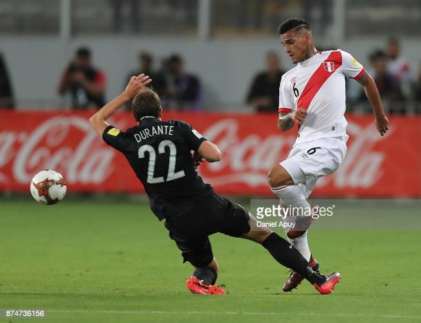 Miguel Trauco and Andrew Durante fight for the ball during a second leg match between Peru and New Zealand as part of the 2018 FIFA World Cup...