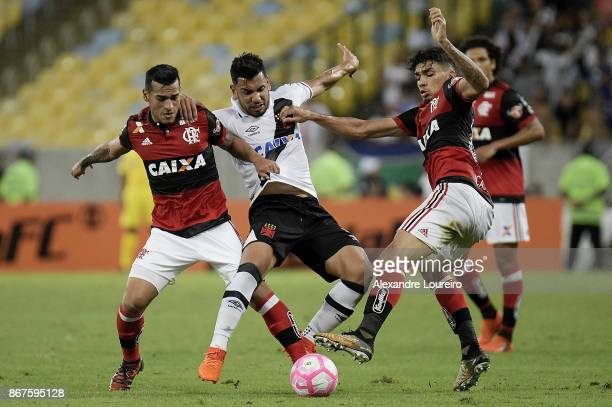 Miguel Trauco and Lucas Paqueta of Flamengo battles for the ball with Andres Rios of Vasco da Gama during the match between Flamengo and Vasco da...