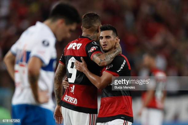 Miguel Trauco and Paolo Guerreo of Flamengo celebrate the victory against Universidad Catolica during a match between Flamengo and Universidad...
