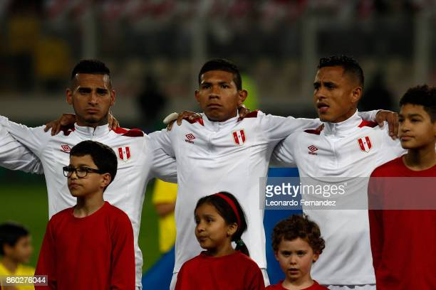 Miguel Trauco Edison Flores and Yoshimar Yotun of Peru line up before the match between Peru and Colombia as part of FIFA 2018 World Cup Qualifiers...
