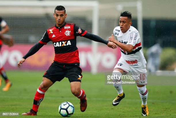 Miguel Trauco of Flamengo and Cueva of Sao Paulo in action during the match between Sao Paulo and Flamengo for the Brasileirao Series A 2017 at...