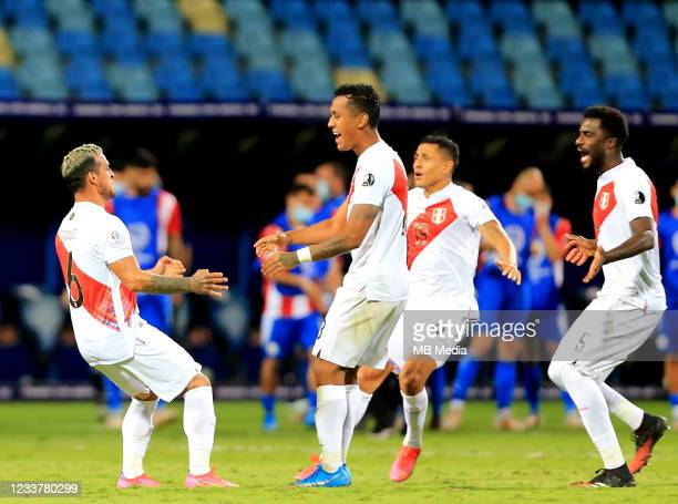 Miguel Trauco of Peru celebrates with his teammates after winning the penalty shootout during the Quarterfinal match between Peru and Paraguay as...