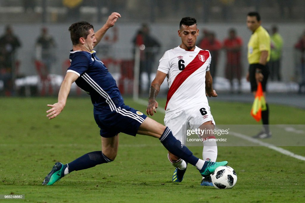 Miguel Trauco of Peru fights for the ball against Kenny McLean of Scotland during the international friendly match between Peru and Scotland at Estadio Nacional de Lima on May 29, 2018 in Lima, Peru.