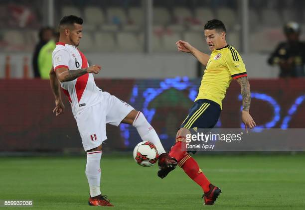 Miguel Trauco of Peru fights for the ball with James Rodriguez of Colombia during a match between Peru and Colombia as part of FIFA 2018 World Cup...