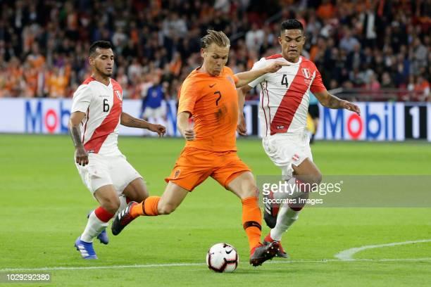 Miguel Trauco of Peru Ruud Vormer of Holland Anderson Santamaria of Peru during the International Friendly match between Holland v Peru at the Johan...