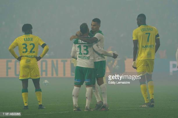 Miguel TRAUCO of Saint Etienne and Timothee KOLODZIEJCZAK of Saint Etienne celebrate after the victory during the Ligue 1 match between Nantes and...