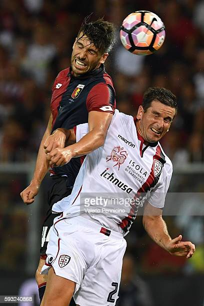 Miguel Veloso of Genoa CFC clashes with Simone Padoin of Cagliari Calcio during the Serie A match between Genoa CFC and Cagliari Calcio at Stadio...