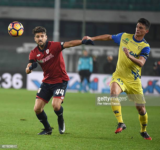 Miguel Veloso of Genoa CFC competes for the ball with Roberto Inglese of AC ChievoVerona during the Serie A match between AC ChievoVerona and Genoa...