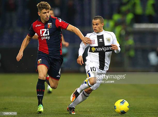 Miguel Veloso of Genoa CFC competes for the ball with Sebastian Giovinco of Parma FC during the Serie A match between Genoa CFC and Parma FC at...