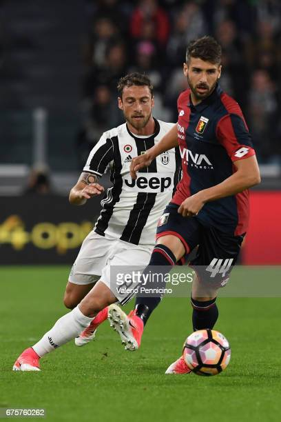 Miguel Veloso of Genoa CFC in action against Claudio Marchisio of Juventus FC during the Serie A match between Juventus FC and Genoa CFC at Juventus...