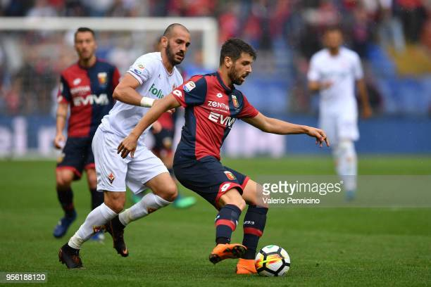 Miguel Veloso of Genoa CFC in action against Riccardo Saponara of ACF Fiorentina during the serie A match between Genoa CFC and ACF Fiorentina at...