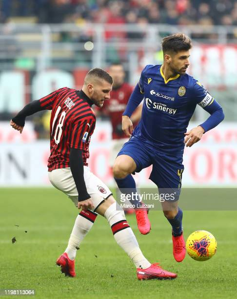 Miguel Veloso of Hellas Verona competes for the ball with Ante Rebic of AC Milan during the Serie A match between AC Milan and Hellas Verona at...