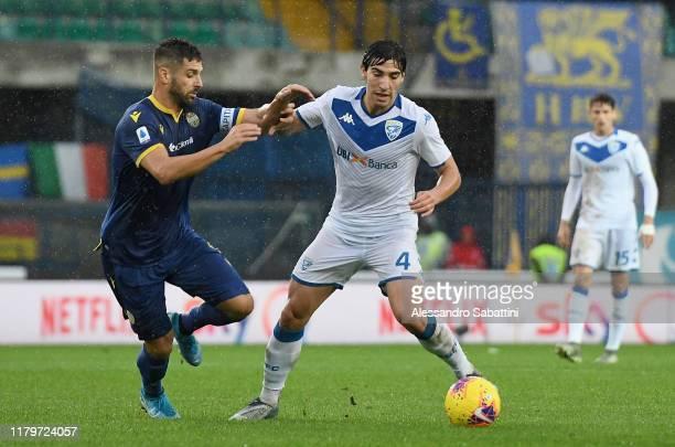 Miguel Veloso of Hellas Verona competes for the ball with Sandro Tonali of Brescia Calcio during the Serie A match between Hellas Verona and Brescia...