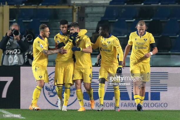 Miguel Veloso of Hellas Verona F.C. Celebrates with teammates after scoring their team's first goal from the penalty spot during the Serie A match...