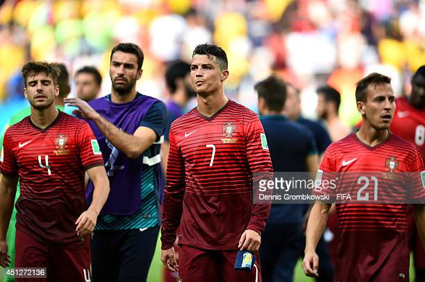 Miguel Veloso of Portugal Cristiano Ronaldo of Portugal and Joao Pereira of Portugal show their dejection after the 2014 FIFA World Cup Brazil Group...