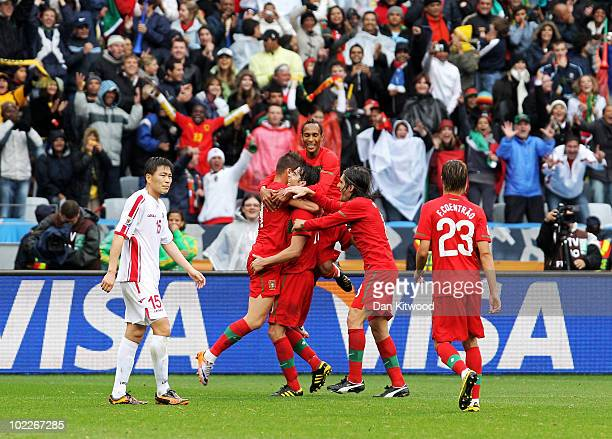 Miguel Veloso of Portugal hugs team mate Tiago after he scores his side's seventh goal during the 2010 FIFA World Cup South Africa Group G match...