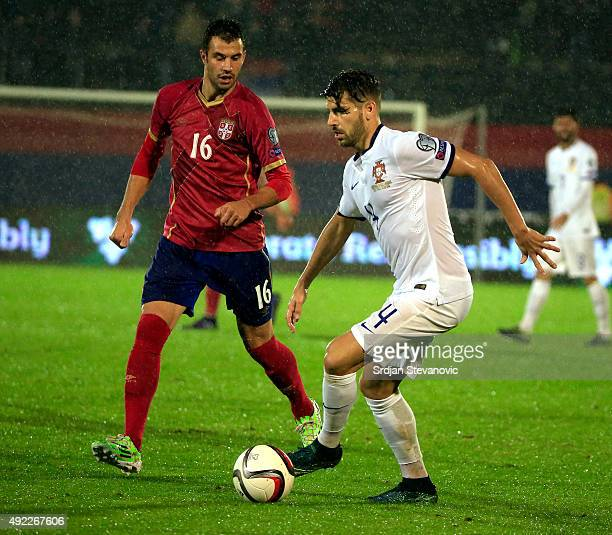 Miguel Veloso of Portugal in action against Luka Milivojevic of Serbia during the Euro 2016 qualifying football match between Serbia and Portugal at...