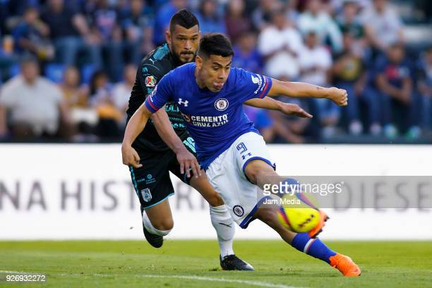 Miguel Zamudio of Queretaro and Felipe Mora of Cruz Azul fight for the ball during the 10th round match between Cruz Azul and Queretaro as part of...