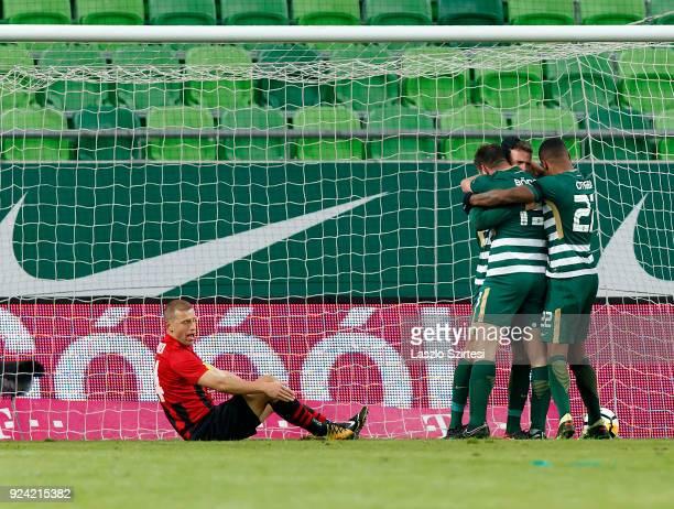 Miha Blazic of Ferencvarosi TC celebrates his goal with teammates next to Djordje Kamber of Budapest Honved during the Hungarian OTP Bank Liga match...