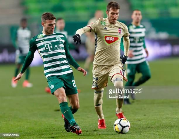 Miha Blazic of Ferencvarosi TC passes the ball next to Marko Scepovic of Videoton FC during the Hungarian OTP Bank Liga match between Ferencvarosi TC...