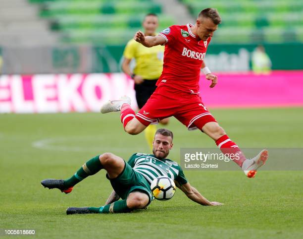 Miha Blazic of Ferencvarosi TC slide tackles Gabor Makrai of DVTK during the Hungarian OTP Bank Liga match between Ferencvarosi TC and DVTK at...