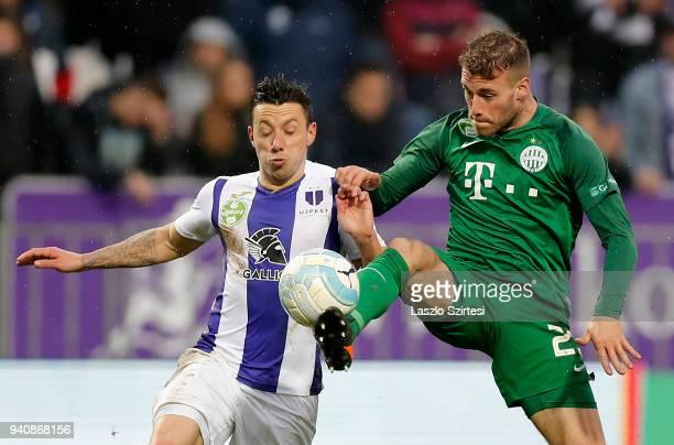 Miha Blazic of Ferencvarosi TC wins the ball from Branko Pauljevic of Ujpest FC during the Hungarian OTP Bank Liga match between Ujpest FC and...