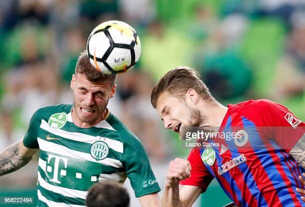 Miha Blazic of Ferencvarosi TC wins the ball from Vit Benes of Vasas FC during the Hungarian OTP Bank Liga match between Ferencvarosi TC and Vasas FC...
