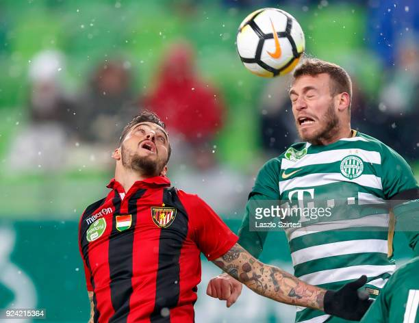 Miha Blazic of Ferencvarosi TC wins the ball in the air from Davide Lanzafame of Budapest Honved during the Hungarian OTP Bank Liga match between...