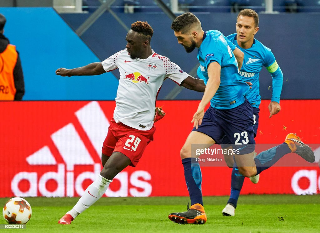 Miha Mevija of FC Zenit vies for the ball with Jean-Kevin Augustin of RB Leipzig during UEFA Europa League Round of 16 match between Zenit St Petersburg and RB Leipzig at the on March 15, 2018 in Saint Petersburg, Russia.