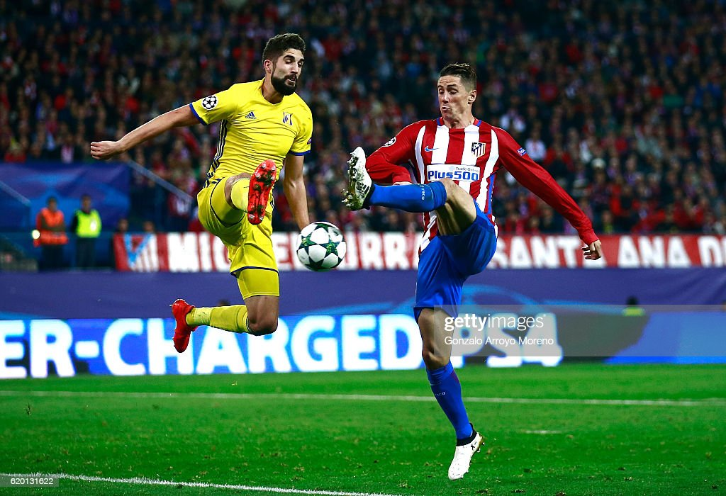 Miha Mevlja of FC Rostov (L) attempts to block a shot from Fernando Torres of Atletico Madrid (R) during the UEFA Champions League Group D match between Club Atletico de Madrid and FC Rostov at Vincente Calderon on November 1, 2016 in Madrid, Spain.