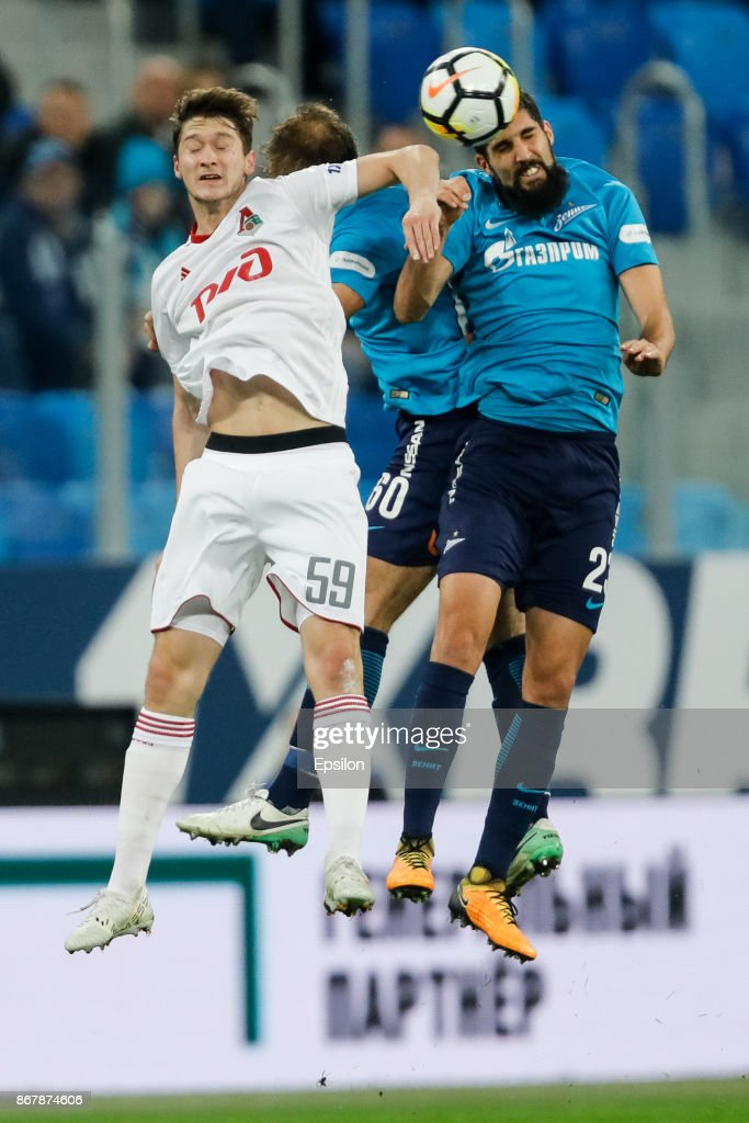 Miha Mevlja (R) of FC Zenit Saint Petersburg, Branislav Ivanovic (C) of FC Zenit Saint Petersburg and Aleksei Miranchuk of FC Lokomotiv Moscow vie for a header during the Russian Football League match between FC Zenit St. Petersburg and FC Lokomotiv Moscow on October 29, 2017 at Saint Petersburg Stadium in Saint Petersburg, Russia.