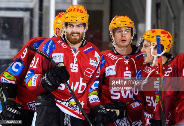 Miha Verlic, Ziga Jeglic and Patch Alber of the Fischtown Pinguins celebrate after scoring the 2:0 during the game between the Fischtown Pinguins...