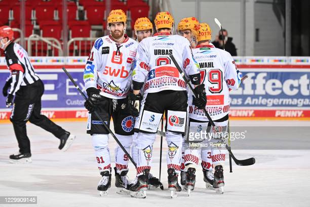 Miha Verlic, Ziga Jeglic, Jan Urbas, Anders Krogsgaard and Mitch Wahl of the Fischtown Pinguins celebrate after scoring the 0:1 during the game...